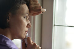 Woman feels sickness at home Stock Photos