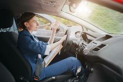 A woman feels stress on the road. Big Traffic jams. Business woman is late for work royalty free stock images
