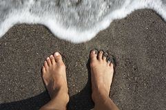 Woman feet. Womans feet with standing by the sea Royalty Free Stock Photography