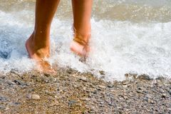Woman feet. In the beach Stock Photos