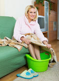 Woman with feet in basin Royalty Free Stock Photo