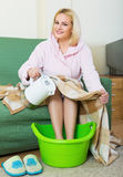 Woman with feet in basin Royalty Free Stock Photos