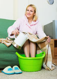 Woman with feet in basin Stock Photo