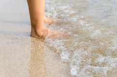 Woman feet on the beach with natural evening light Royalty Free Stock Images