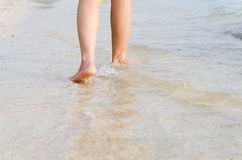 Woman feet on the beach with natural evening Royalty Free Stock Photos