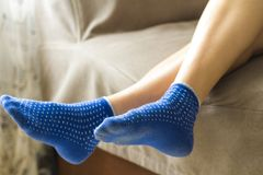 Woman feet in blue socks.Relaxing and comfort holiday concept. Stock Image