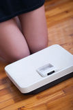 Woman feet and body weight scale Stock Photo