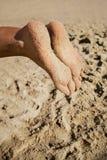 Woman feet closeup of girl relaxing on beach Stock Image
