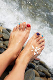 Woman feet closeup of girl relaxing on beach on sunbed enjoying Stock Photos