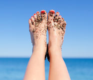 Woman feet closeup of girl relaxing on beach Stock Photography