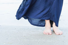 Woman feet closeup of girl relaxing on beach. Vacation holidays. Woman feet closeup of girl relaxing on beach Stock Photo