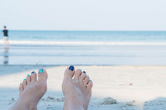 Woman feet closeup of girl relaxing on beach Stock Image