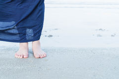 Woman feet closeup of girl relaxing on beach. Vacation holidays. Woman feet closeup of girl relaxing on beach Stock Images