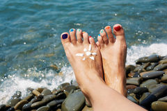 Woman feet closeup of girl relaxing on beach Stock Images