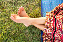 Woman feet closeup of girl relaxing Stock Photo