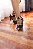 Woman feet in dance position. Woman with black sandals in dance position Stock Photos