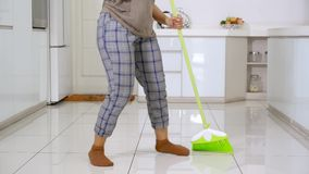 Woman feet dancing while cleaning floor