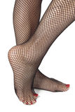 Woman feet with fishnet tights  over white Stock Photo