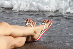 Woman Feet with flip flops on the Beach Royalty Free Stock Photo