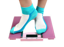 Woman feet on floor scales Royalty Free Stock Photography