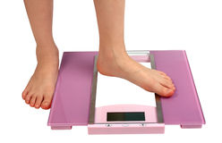 Woman feet on floor scales Royalty Free Stock Images