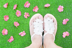Woman feet with flowers Royalty Free Stock Photo