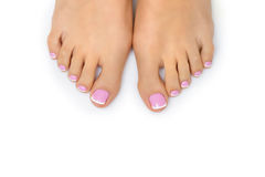 Woman feet with french pedicure Royalty Free Stock Photo