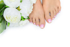 Woman feet with french pedicure Royalty Free Stock Photography