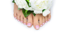 Woman feet with french pedicure Stock Images
