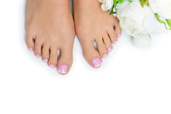 Woman feet with french pedicure Royalty Free Stock Images