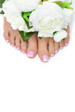 Woman feet with french pedicure Royalty Free Stock Photos