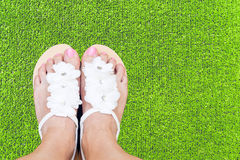 Woman feet on grass royalty free stock photos
