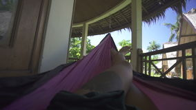 Woman feet in hammock on the beach. Relax woman feet in hammock on the beach stock video footage