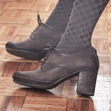 Woman feet in high heels Stock Photo