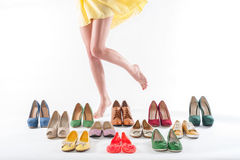 Woman Feet And Multiple Shoes Royalty Free Stock Image