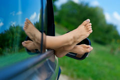 Woman feet out of car window Royalty Free Stock Image