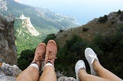Woman feet over mountains Royalty Free Stock Photos