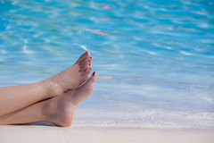 Woman feet on the pool Royalty Free Stock Photography