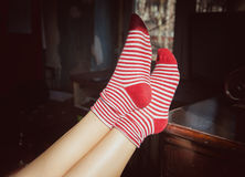 Woman feet in red socks. Relax concept Royalty Free Stock Photos