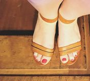 Woman feet. With red toenail polish Royalty Free Stock Photos