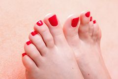 Woman feet with red toenails Royalty Free Stock Image