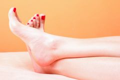 Woman feet with red toenails on towel Royalty Free Stock Photos
