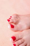 Woman feet with red toenails on towel Stock Image