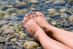 Woman feet relax. In the beach Royalty Free Stock Photography