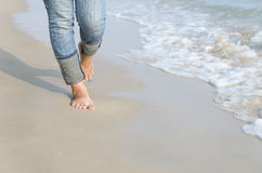 Woman feet relax walk on beach Stock Images
