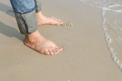 Woman feet relax walk on beach Royalty Free Stock Photos