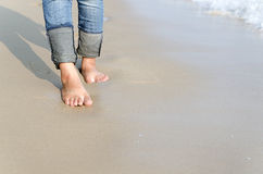 Woman feet relax walk on beach Royalty Free Stock Photography