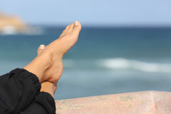 Woman feet relaxing on an hotel beach terrace Royalty Free Stock Photo