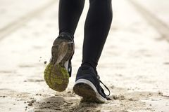 Woman feet running on sand Royalty Free Stock Photography