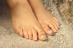 Woman feet on sand Royalty Free Stock Photos